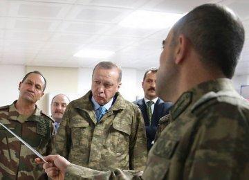 Erdogan Threatens to Expand Syria Offensive Despite Criticism