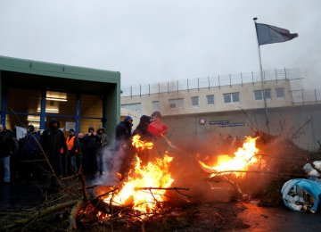 Prison wardens block the Maubeuge jail during a nationwide protest in France on January 24.