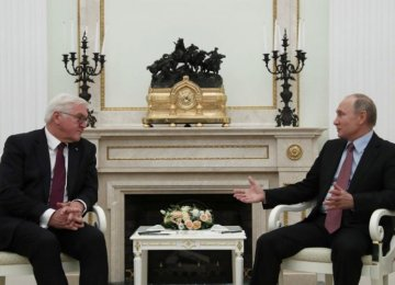 Russian President Vladimir Putin (R) meets  German President Frank Walter Steinmeier at the Kremlin in Moscow, Russia,  on October 25.