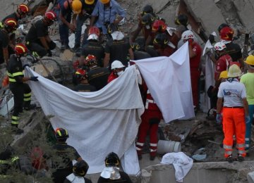 Rescuers work amid the rubble of a building that collapsed in Torre Annunziata, near Naples, southern Italy, on July 7.