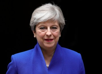 May Strikes Deal With DUP