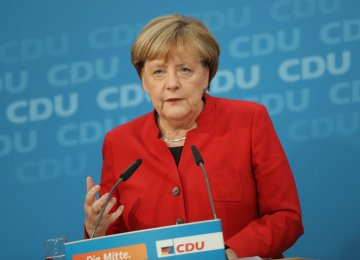 Merkel Rejects Refugee Limit for Germany