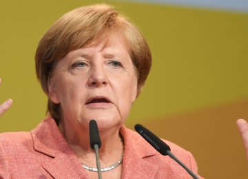 Merkel Stands by Border Opening  to Refugees