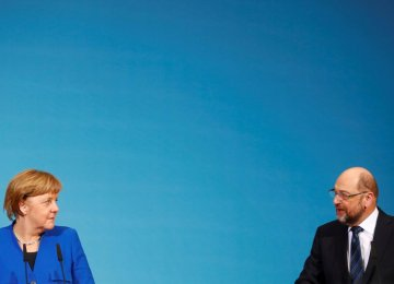 Chancellor Angela Merkel (L) and Martin Schulz attend  a news conference in Berlin on January 12.