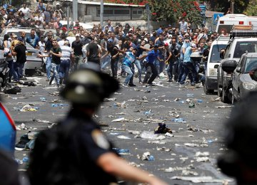Palestinians clash with Israeli security forces outside  Beit-ul-Moqadass on June 21.