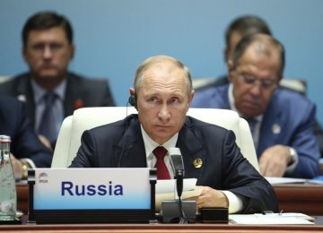Russian President Vladimir Putin attends the Dialogue of Emerging Market and Developing Countries  on the sideline of the BRICS Summit in Xiamen, China on Sept. 5