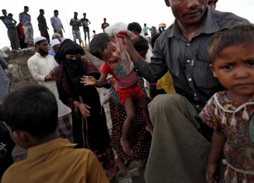 Newly arrived Rohingya refugees board a boat as they transfer to a camp in Cox's Bazar, Bangladesh on October 2.