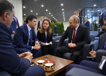 Iraqi Kurdish Prime Minister Nechirvan Barzani (L) in a meeting with Russian President Vladimir Putin in Saint Petersburg in June.