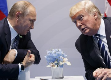 US President Donald Trump (L) shakes hands with Russian President Vladimir Putin during their meeting on the sidelines of the G20 summit in Hamburg on July 7.