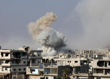 Smoke rises after shelling on a militant-held area of Deraa, Syria, on June 4.