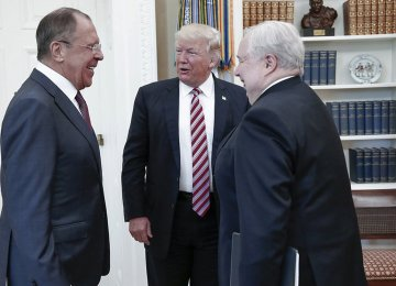 (L-R) Sergey Lavrov, Donald Trump and Sergey Kislyak at the White House, Washington, DC, May 10