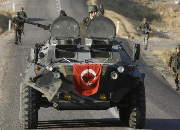 Turkey intervened militarily in northern Syria to contain both Kurdish factions and the IS.