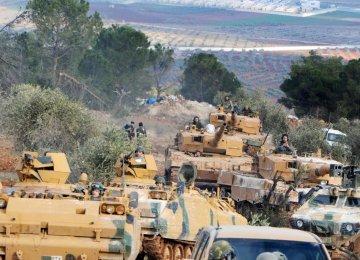 Turkish Forces Surround Syrian Kurdish City