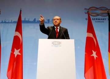 Turkish President Recep Tayyip Erdogan speaks during a news conference to present the outcome of the G20 leaders' summit in Hamburg, Germany on July 8.