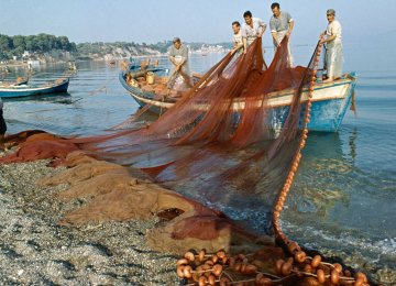 Fishermen at work in Evia, Greece (File Photo)