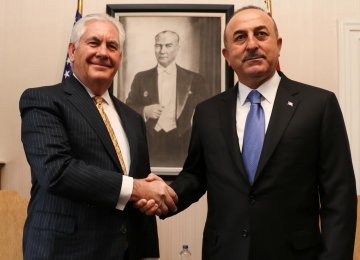 US Secretary of State Rex Tillerson (L) shakes hands with his Turkish counterpart, Mevlut Cavusoglu, in Ankara on Feb. 16.