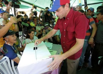 Opposition leader Henrique Capriles casts his ballot during a symbolic referendum in Caracas on July 16.