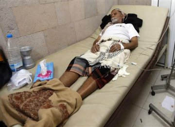 A Yemeni man suspected of being infected with cholera receives treatment at a makeshift hospital in Sana'a on July 13.