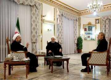 President Hassan Rouhani is flanked by Judiciary Chief Sadeq Amoli Larijani (L) and Parliament Speaker Ali Larijani in Tehran on Nov. 11.