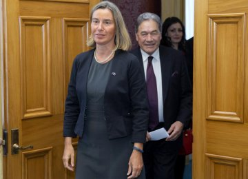 Federica Mogherini, European Union foreign policy chief (L), and New Zealand Foreign Minister Winston Peters arrive for a press conference after their meeting at parliament in Wellington, New Zealand, on Aug. 7.