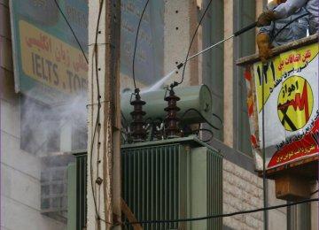 Crews clean a power transformer in Ahvaz, Khuzestan Province.