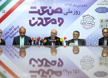 Industries Minister Mohammad Reza Nematzadeh (C) addressing a presser on the occasion of the National Day of Industry and Mine in Tehran on July 1.