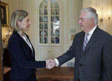 Federica Mogherini (L) and Rex Tillerson