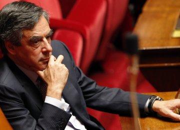 French Socialists Vote  as Turmoil Engulfs Fillon