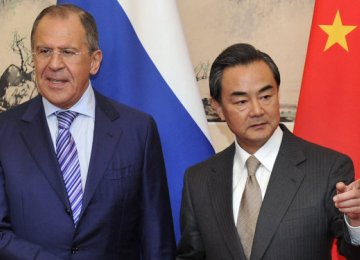 Wang Yi (R) and Sergey Lavrov