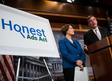 Democratic Senators Amy Klobuchar (L) and Mark Warner introduced the Honest Ads Act, in Washington, D.C. on Oct. 19.