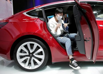 A Tesla Model 3 car during a media preview at the Auto China 2018 motor show in Beijing on April 25 (File Photo)