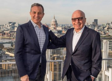Disney chairman CEO Robert Iger (L) and 21st Century Fox executive chairman Rupert Murdoch