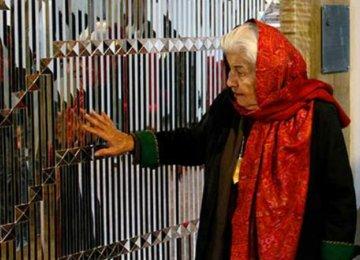 Monir Farmanfarmaian caressing her work