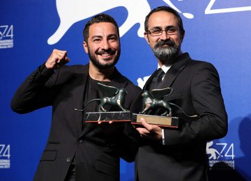 Navid Mohammadzadeh (L) and Vahid Jalilvand won the best actor and best director awards at the 74th Venice Film Festival.