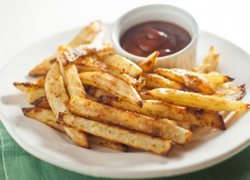 While potatoes can form part of a healthful diet, studies suggest that eating too many may pose health risks.