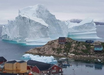 Huge Iceberg Drifts Close to Greenland Village