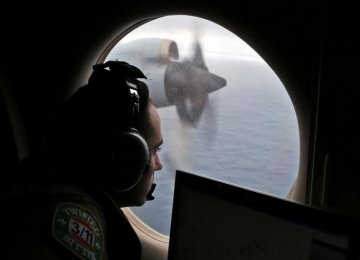 a full report into MH370's disappearance would be published in the near future.