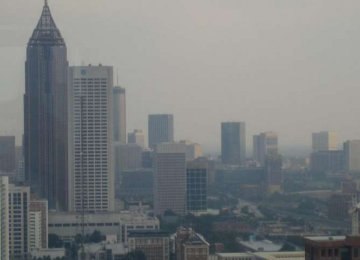 Cool Roofing Materials Worsen Air Pollution