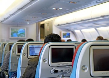 People's use of smartphones and tablets is making in-flight screens obsolete,