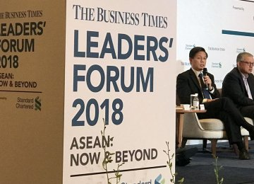 Chan Chun Sing (L) and CEO of the Singapore Business Federation Ho Meng Kit,  at The Business Times Leaders Forum on Monday.