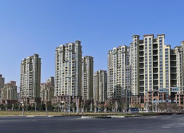 China's property market is cooling due to tighter down-payment requirements and restricting non-resident buyers.