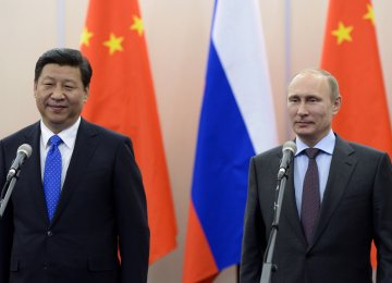 File photo of Russian President Vladimir Putin (L) and Chinese leader Xi Jinping in Beijing in April.