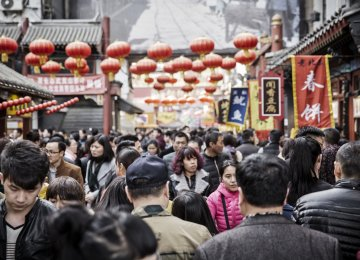 China Cuts Debt While Sustaining Growth