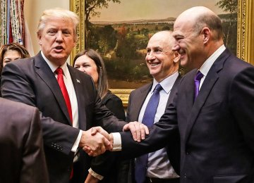 Gary Cohn and Peter Navarro are both valued members of the president's economic team. The picture shows President Trump shaking hands with Cohn.