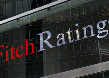 Fitch says China's economic growth has come at the cost of delayed reforms.