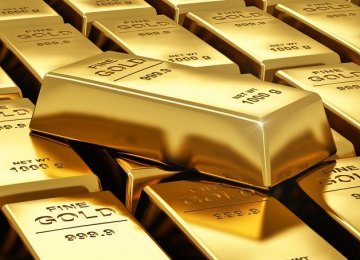 Gold Slides as Dollar Recovers