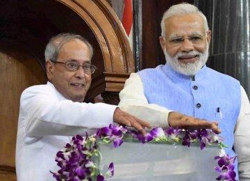 President Pranab Mukherjee (L) and Prime Minister  Narendra Modi launch the GST in the Central Hall  of Parliament in New Delhi on Saturday.