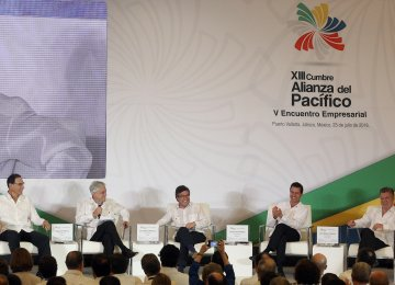 (L - R) Peruvian President Martin Vizcarra, Chilean President Sebastian Pinera, the president of the Inter-American Development Bank Luis Alberto Moreno, Mexican President Enrique Pena Nieto and Colombian President Juan Manuel Santos, at the Business Meeting  of the Pacific Alliance in Mexico on Monday.
