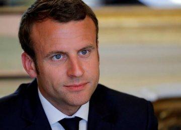 Macron Told to Improve Finances