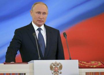 Vladimir Putin begins historic fourth term as president.